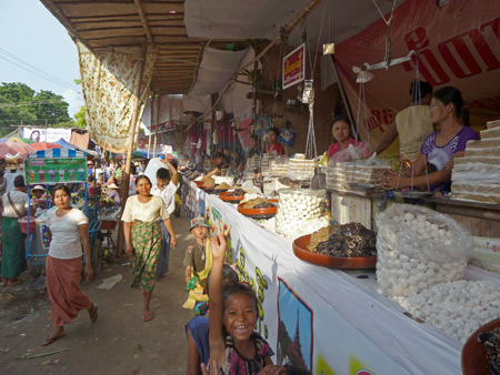 Sweet ladies quench your sweet tooth at the Nat Pwe in Taungbyone, Myanmar.