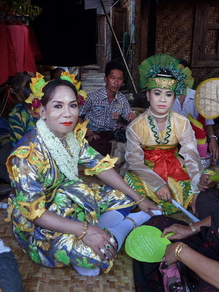 A couple of nat kadaws relax at the Nat Pwe in Taungbyone, Myanmar.