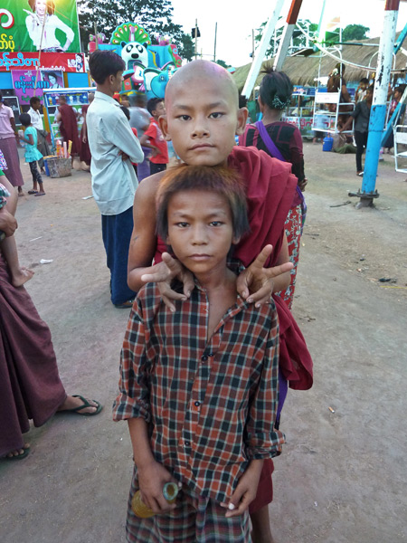 This Buddhist kid asked me to take a photo of him and his friend. A split second later, they were gone at the Nat Pwe in Taungbyone, Myanmar.