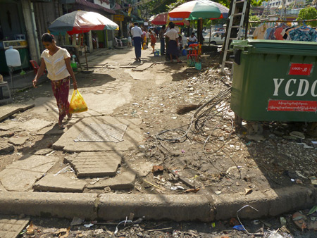 Cracked sidewalk bliss in Yangon, Myanmar.