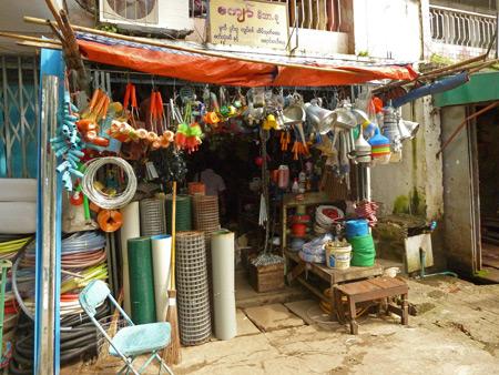 A typical sidewalk shop cave in Yangon, Myanmar.