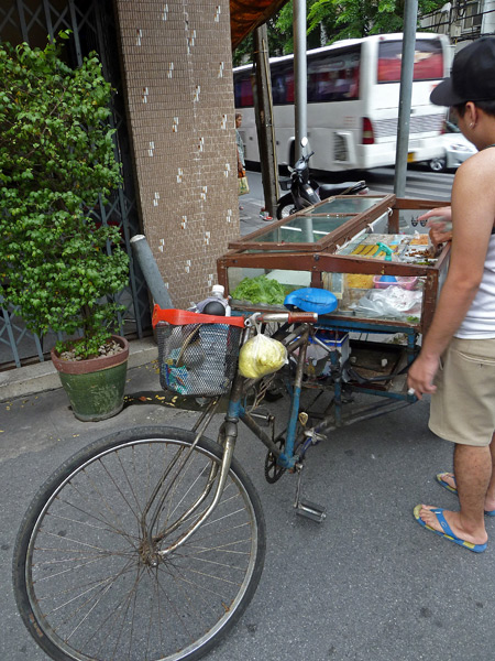A low-slung bicycle food cart in Bangkok, Thailand.