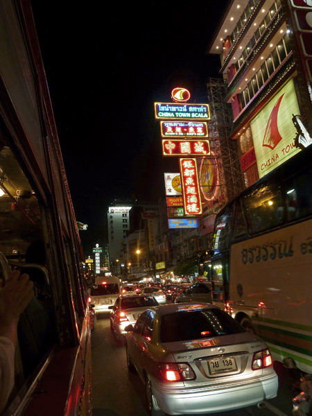 A street in Chinatown, as seen from the bus in Bangkok, Thailand.
