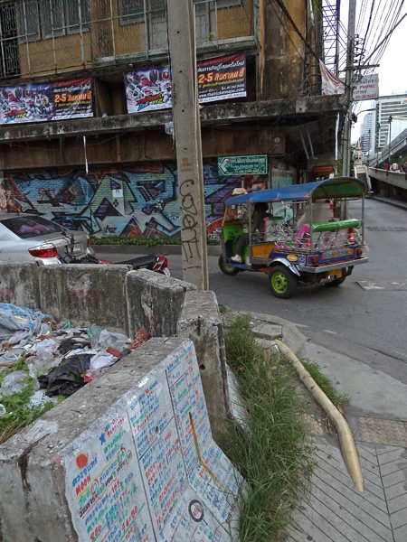 A colorful, grit-covered corner in Bangkok, Thailand.