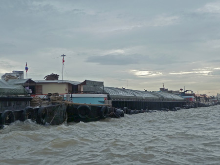 A long-ass barge on the Chao Phraya river in Bangkok, Thailand.