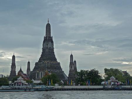 Wat Arun, as seen from the Chao Phraya river in Bangkok, Thailand.