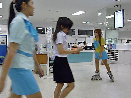 A messenger girl on fruit boots at Yanhee Hospital in Bangkok, Thailand.
