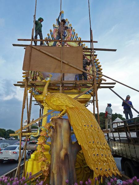 Men hard at work on a median decoration on Thanon Ratchadamnoen in Banglamphu, Bangkok, Thailand.