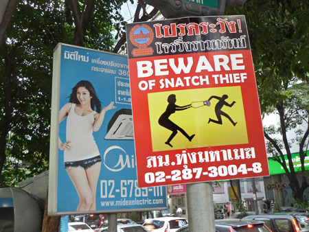 Beware of snatch thief on Thanon Silom in Bangkok, Thailand.
