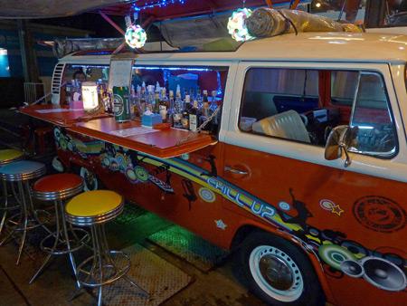 A bar in a Volkswagen van outside on the sidewalk near Thanon Sukhumvit in Bangkok, Thailand.