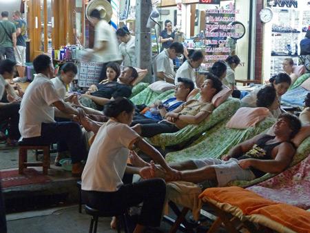 A foot massage frenzy on Thanon Khao San in Banglamphu, Bangkok, Thailand.