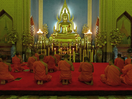 Buddhist monks sing inside the temple at Wat Benchamabophit in Bangkok, Thailand.