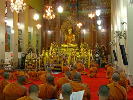 Buddhist monks sing during a prayer service at Wat Chanasongkhram in Banglamphu, Bangkok, Thailand.