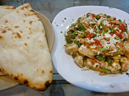 A plate of vegetable matter and naan at  the Blue Sky Cafe in Kolkata, India.