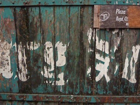 A grotty green gate on Royd Street in Kolkata, India.