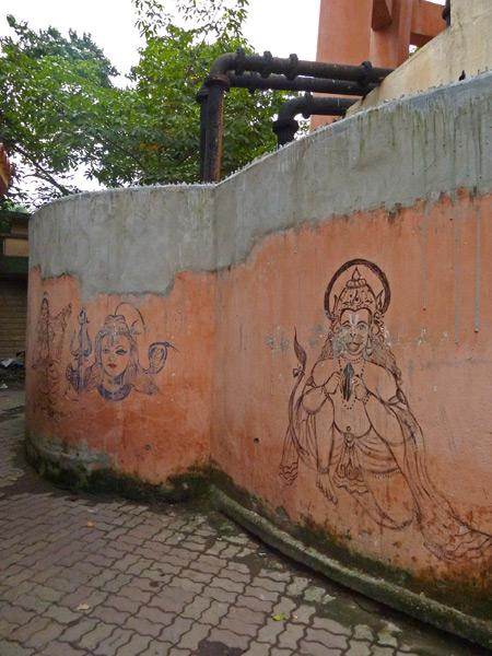 A fancifully festooned wall at a Hindu temple near the Esplanade bus station in Kolkata, India.