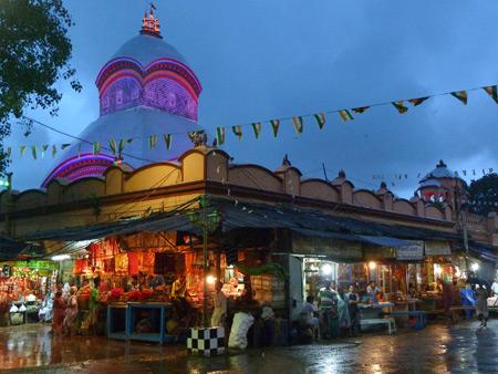 The Kali temple glows at dusk in Kolkata, India.