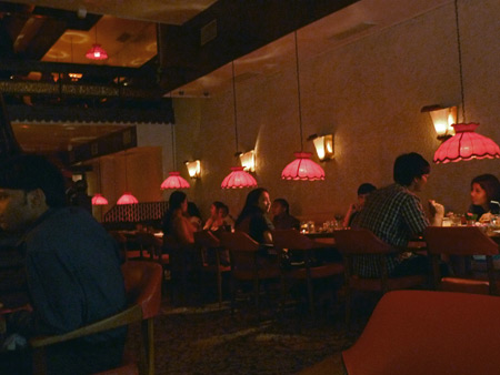 The dimly-lit interior of Peter Cat in Kolkata, India.