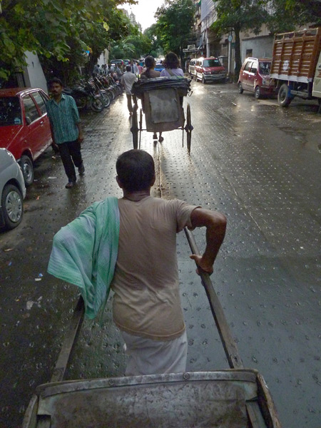 A rickshaw driver / professional extortionist hauls me over to the Blue Sky Cafe on Sudder Street in Kolkata, India.