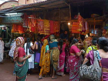 A blizzard of bright saris outside the Kali temple in Kolkata, India.