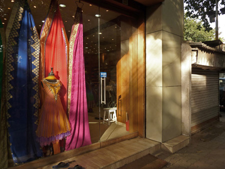 A sari shop glows in the setting sunlight in Kolkata, India.
