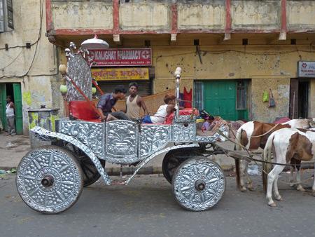 A regal horse drawn carriage near the Kali temple in Kolkata, India.