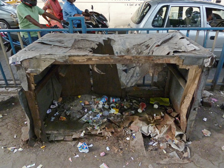 A way station for sidewalk debris on (A/C) Bose Road in Kolkata, India.