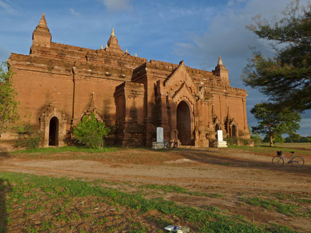 The massive fort-like Pyathada Paya glows in the setting sunlight in Bagan, Myanmar.