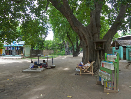 Locals relax in the roadside shade in Nyaung-U, Myanmar.