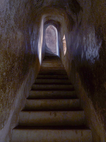 The steep, cave-like stairwell inside Shwegugyi Buddhist temple in Old Bagan, Myanmar.