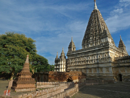 Mahabodhi Buddhist temple gleams in the sunlight in Old Bagan, Myanmar.