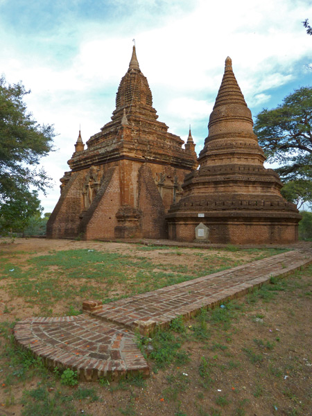 More magnificent Buddhist temples along the road at sunset in Bagan, Myanmar.