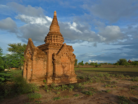 A picturesque templet sits in the golden light of a perfect Bagan, Myanmar evening.