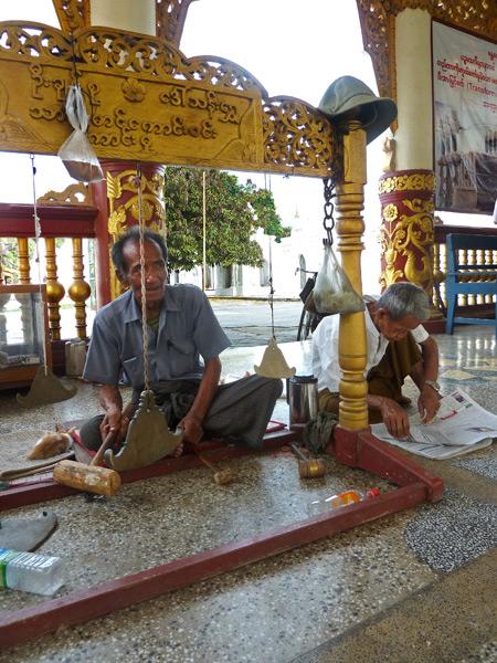 A man hammers chimes at Kuthodaw Pagoda in Mandalay, Myanmar.