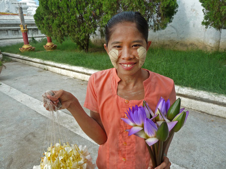 A flower seller out in front of  Kuthodaw Pagoda in Mandalay, Myanmar.