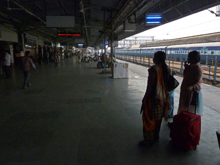 Passengers wait for a train at the Agra Cantonment train station in Agra, India.