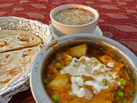 Vegetable soup, naan and potato curry at  the Hotel Kamal's rooftop cafe in Agra, India.