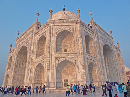 The Taj Mahal mausoleum bathed in the setting sunlight in Agra, India.