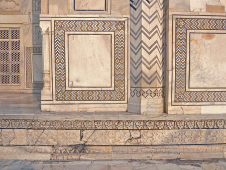 A close-up of the intricately patterned stonework on the Taj Mahal mausoleum in Agra, India.