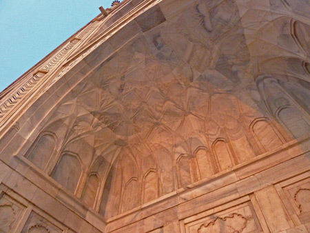 Looking up at one of the Taj Mahal's beautiful arches in Agra, India.