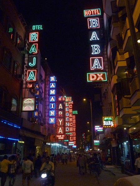 Neon hotel signs rule Arakashan Road in Paharganj, Delhi, India.