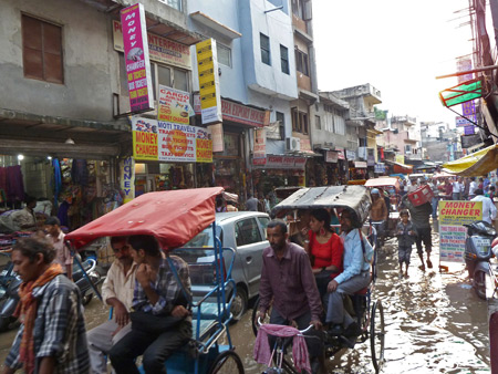 A flooded street in the Main Bazaar of Paharganj, Delhi, India.