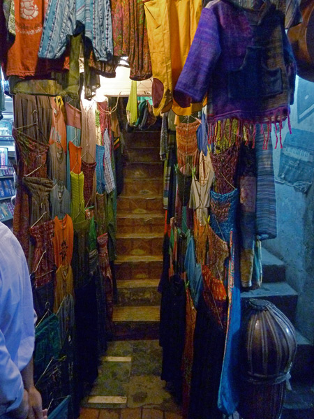 A cave-like entrance to a clothing shop for hippies in the Main Bazaar of Paharganj, Delhi, India.