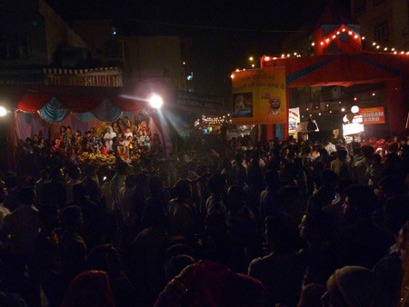 A jam-packed crowd enjoys the Hindu Valmiki Jayanti festival on Desh Bandhu Gupta Road in Paharganj, Delhi, India.