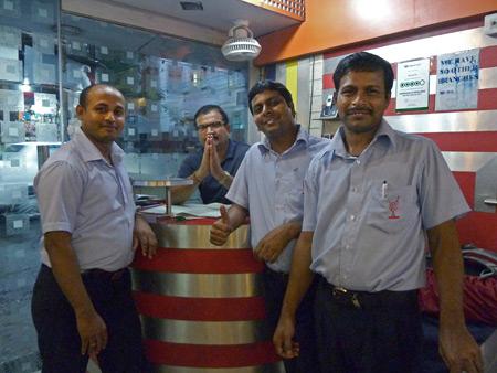Waiters at the Blue Sky Cafe in Kolkata, India.