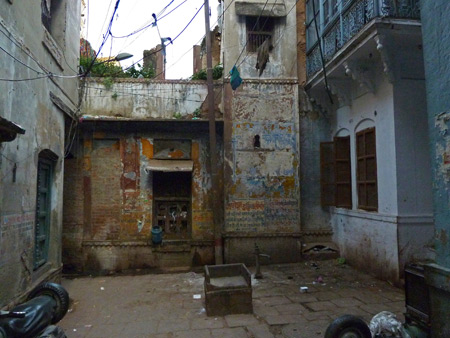 A weathered wall in the back lanes of Varanasi, India.