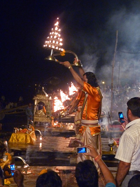 Men perform a Hindu ritual with fire at the nightly Ganga Aarti ceremony at Dasaswamedh Ghat in Varanasi, India.