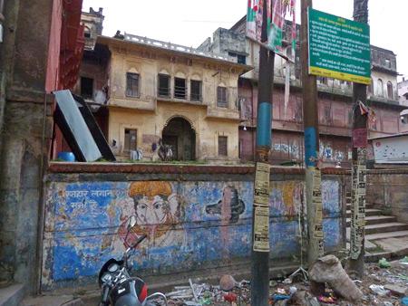 A weathered wall in a back lane off Chowk Godowlia Road in Varanasi, India.