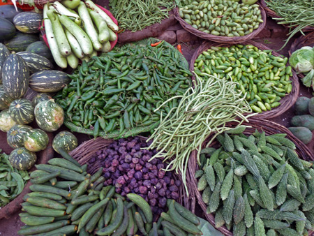 Green produce for sale in a street market area of Varanasi, India.