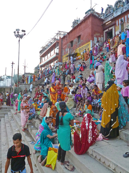 A colorful crowd gathers for Hindu ceremonies and just to relax at Kedar Ghat in Varanasi, India.